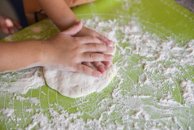 Hands knead the dough homemade pastry for bread or pizza bakery