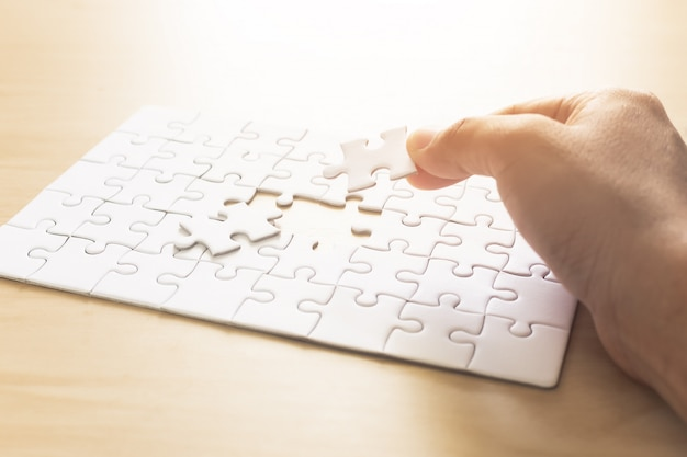 Hands of man jigsaw puzzle connecting.
