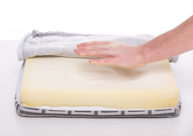 Hands of man with nice mattress that supported you to sleep.