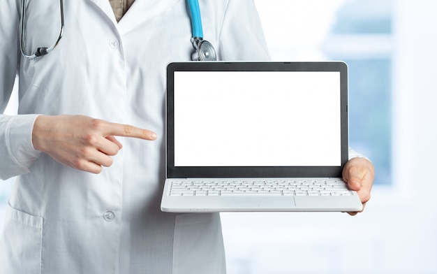 Hands of medical doctor woman with laptop