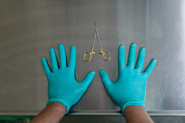 Hands and medical instruments. plastic surgery