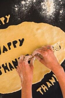 Hands molding dough