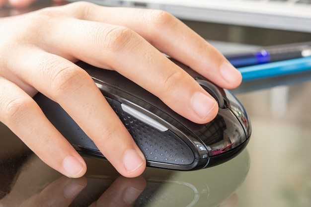 Hands and mouse and notebook computer