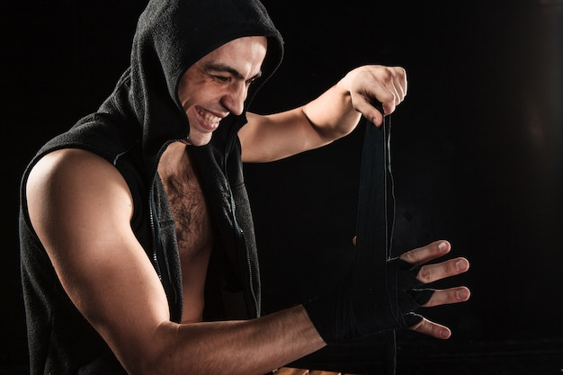 Hands of muscular man with bandage