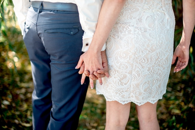 Hands of newlyweds with wedding rings