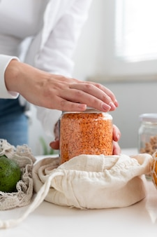 Hands opening jar close up
