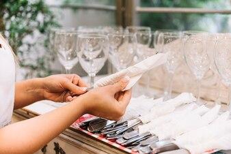 Hands organizing cutlery