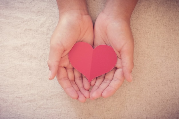 Hands and paper red heart