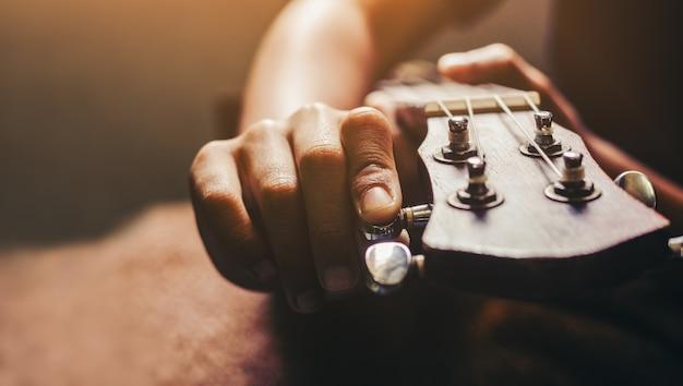 Hands playing acoustic ukulele guitar.music skills show