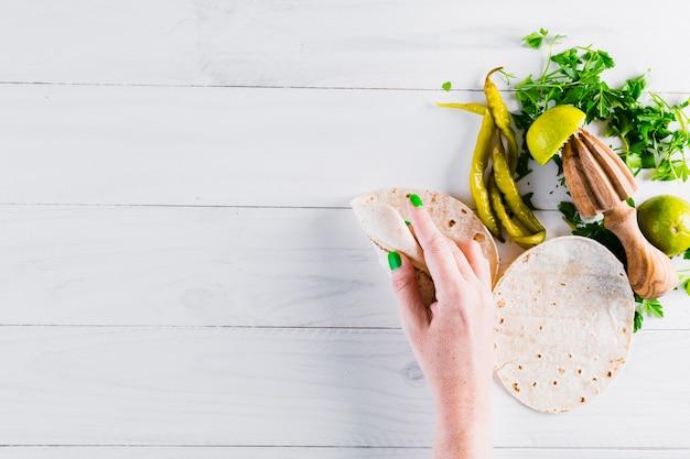 Hands preparing tasty mexican food