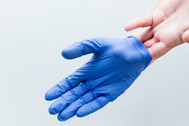 Hands properly removing surgical gloves fase