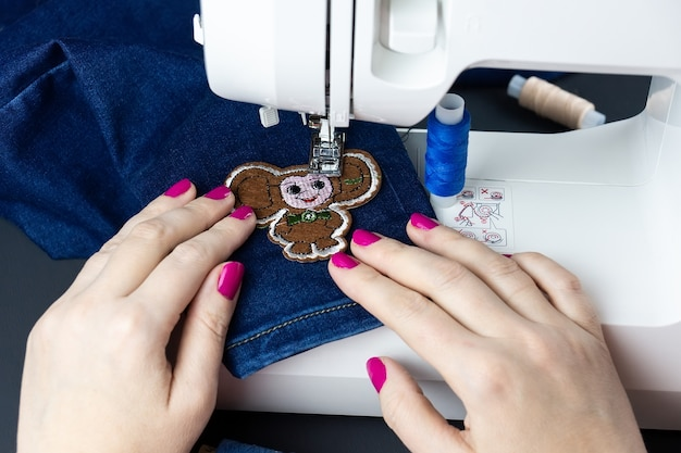 Hands on the sewing machine