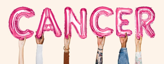 Hands showing cancer balloons word Free Photo