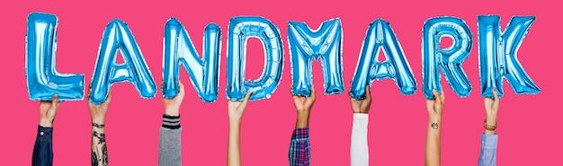 Hands showing landmark balloons word