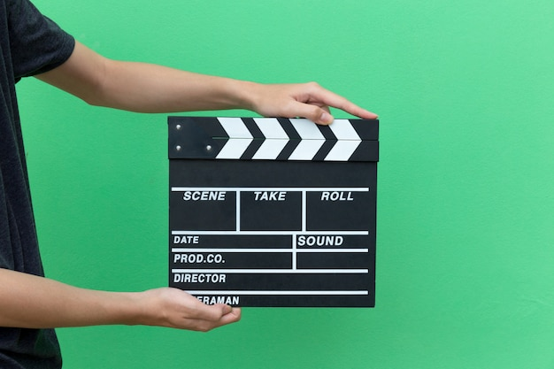 Hands take movie clapper board slate equipment film action for shouting the movie.