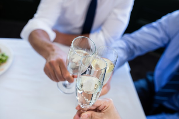 Hands toasting champagne flutes