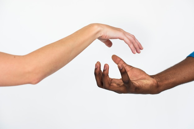 Hands together multiethnic unity concept