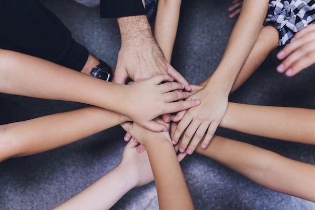 Hands together on team