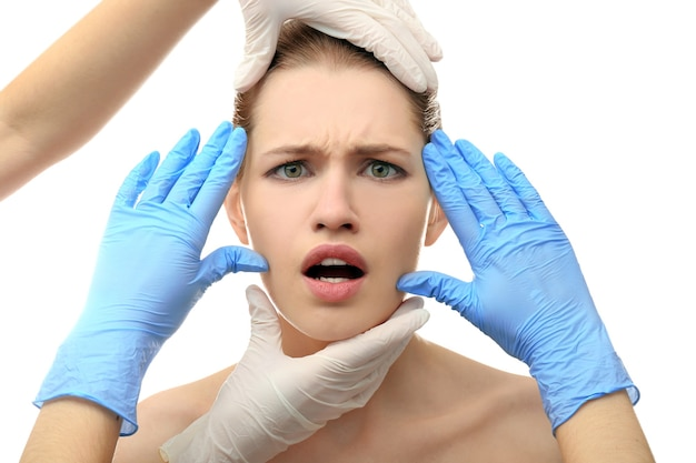 Hands touching female face. plastic surgery concept