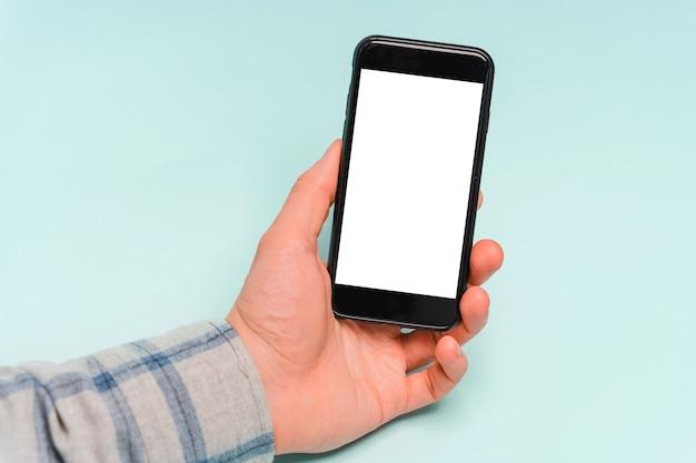 손 사용 휴대 전화, 복사 공간, 파란색 배경