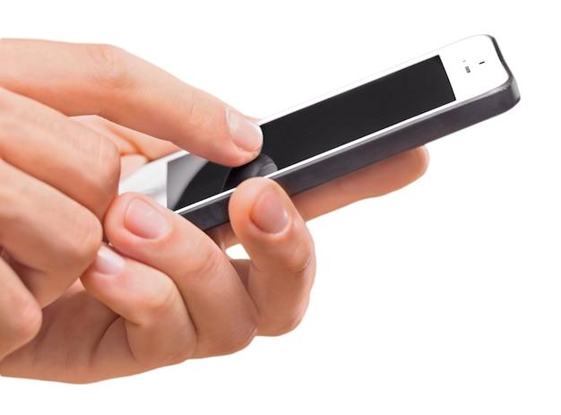 黒い画面でiphoneを使用している手
