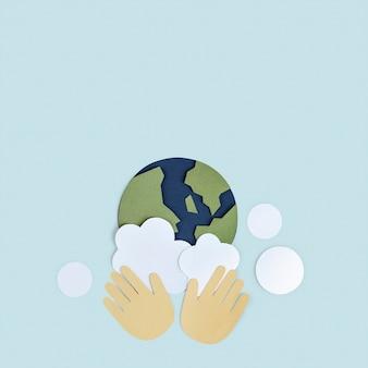 惑星地球ペーパークラフトの背景を洗う手