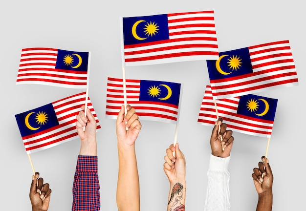 Hands waving flags of malaysia
