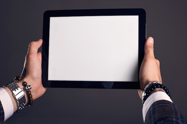 Hands with digital tablet
