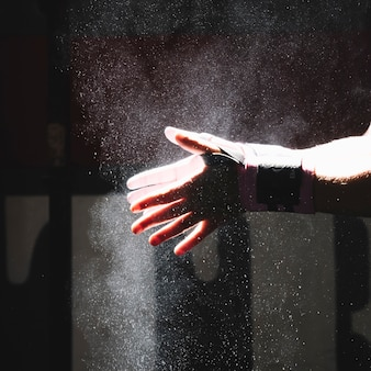 Hands with magnesium in gym
