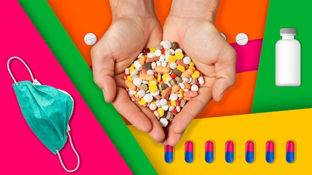 カラフルな背景の薬と手