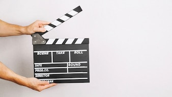 Hands with opened clapperboard