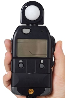 Hands with a photometer to measure the light in the scene