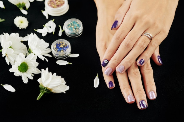 Hands with purple and silver design