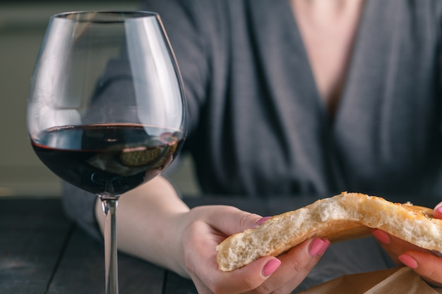 Hands of a woman breaking and sharing bread