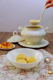 Hands of a woman prepares matzah balls, ashkenazi jewish soup dumpling