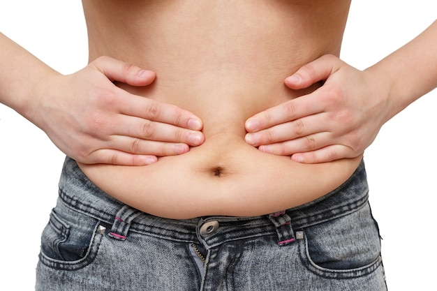 Hands woman presses excess fat on the sides of the abdomen. on white background, front view