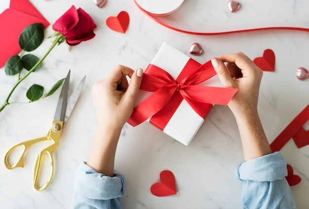 Hands wrapping a sweet present