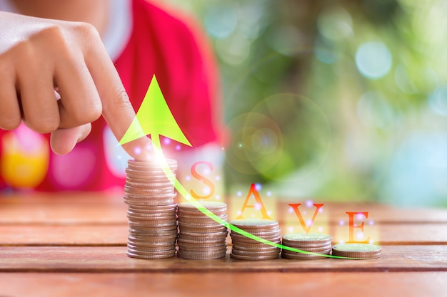 Hands of young asian girls saving money on the stairs learn to save money use the concept of saving