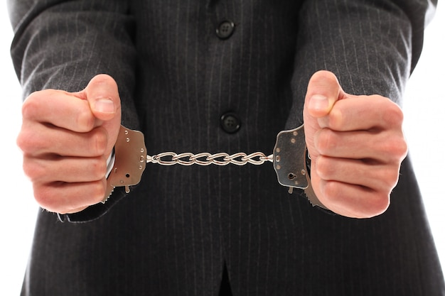 Hands of young man in handcuffs