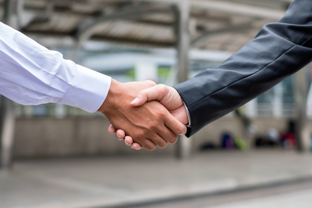Handshake agreement of businessman with partnership in the city