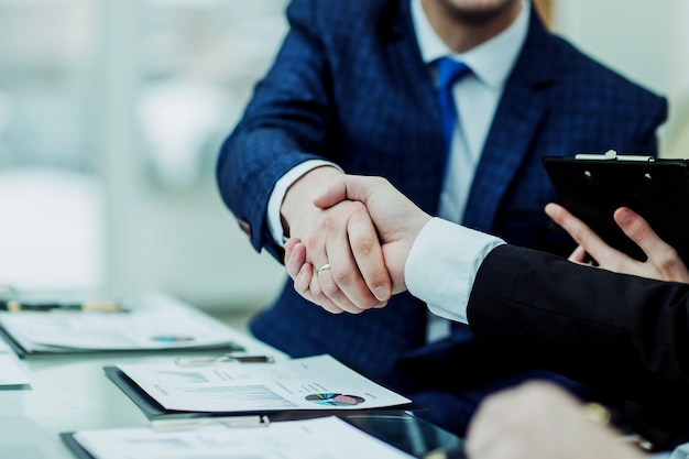 Handshake business partners after discussion