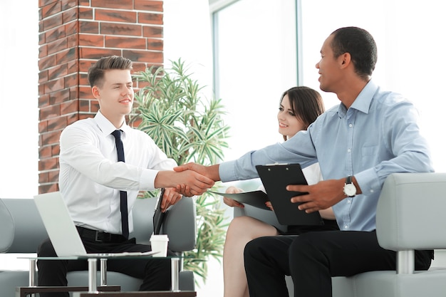 Handshake business partners before a business meeting