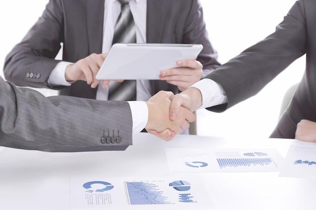 Handshake of business people in meeting attendance.
