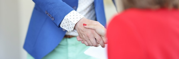 Handshake of businessman and businesswoman business communication and negotiation