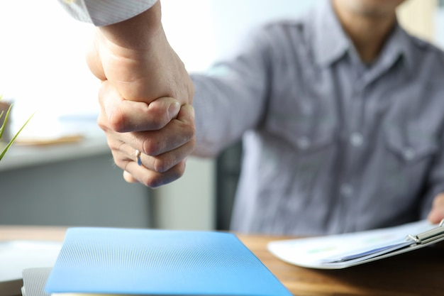 Handshake of colleagues in office