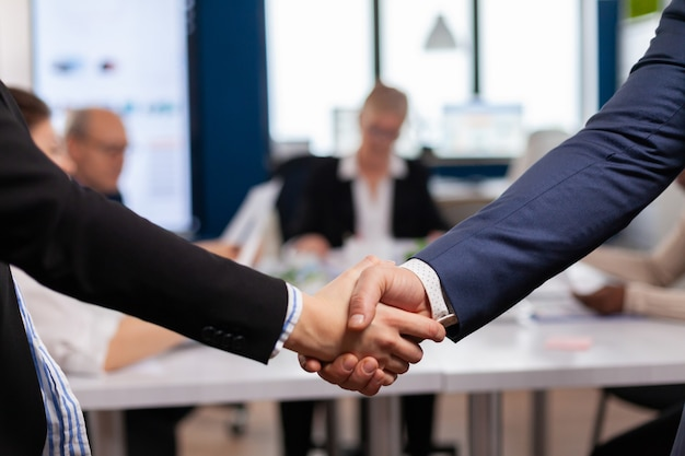 Handshake in conference room