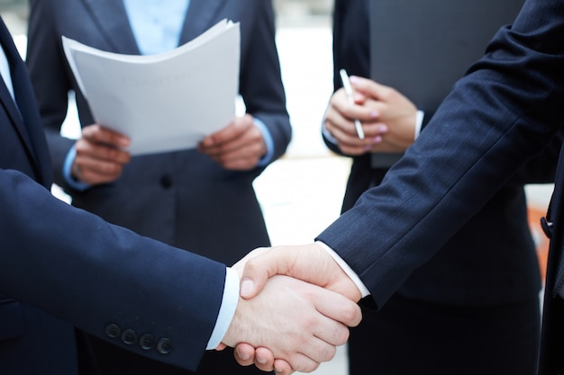 Handshake of executives greeting each other
