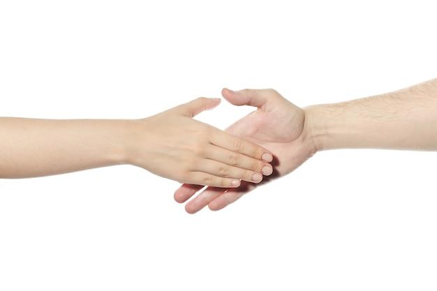 Жест рукопожатия. мужчина и женщина пожимают друг другу руки. приветствие, удачная сделка и символ договоренности. белый изолированный фон