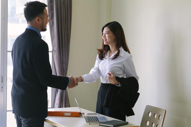 Handshake of male and female businessmen.