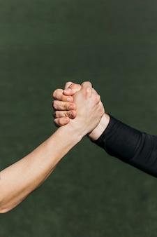 Handshake on football field